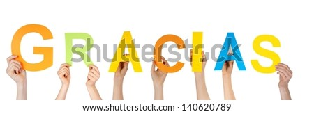 many hands holding the spanish word gracias which means thanks, isolated