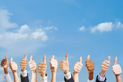 Many hands holding thumbs up as motivation at work concept