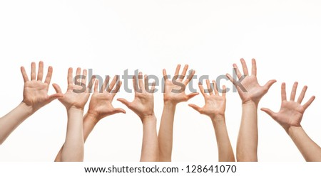 Many hands reaching out in the air, white background, copy space
