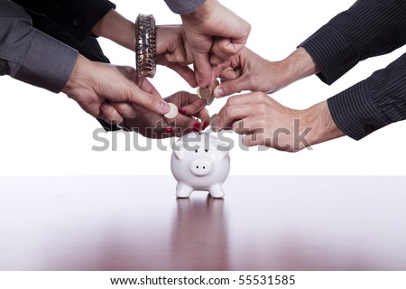 Many hands saving money in the piggy bank