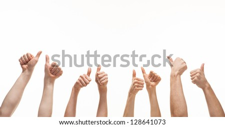 Many hands showing thumb up signs on white background