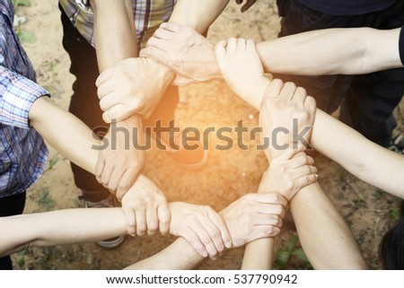 Many hands together holding hand to collaborate on some duty. #537790942