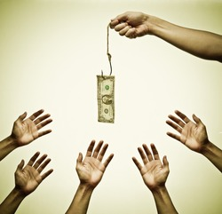 Many hands trying to get a dollar banknote hung on a fish hook