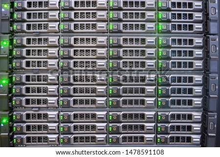 Many hard drives are in a powerful database server. Computer equipment for hosting services. Front panel of access server.