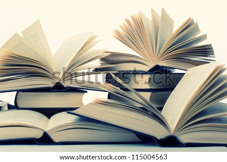 Many hardcover books. Toned image