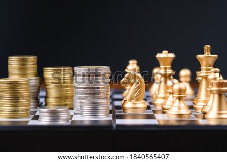 Many heap of coins on chessboard game with rival team, business strategy,  financial plan and investment concept Photo stock ©