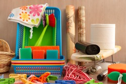 Many household goods. Ironing board, plastic boxes, toilet paper, garbage bags, parallon sponges, clothespins are household utensils. Household items for everyday life.