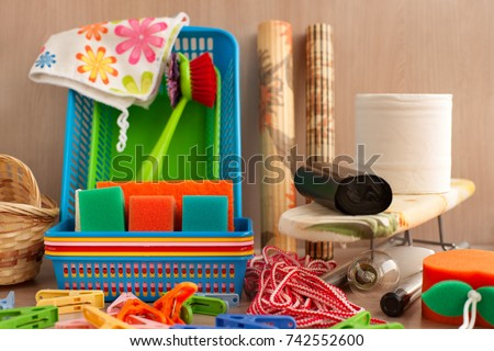 Many household goods. Ironing board, plastic boxes, toilet paper, garbage bags, parallon sponges, clothespins are household utensils. Household items for everyday life. #742552600