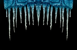 many icicles on black background isolate close-up