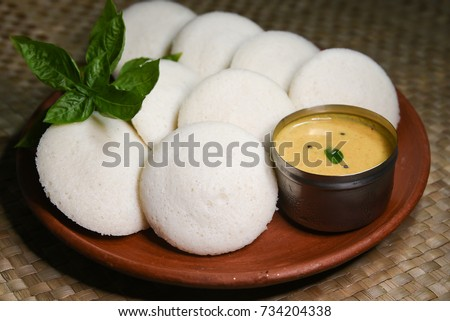 Many Idli with coconut chutney, popular South Indian breakfast dish made with lentil, rice. prepared by steaming fermented batter. Healthy and oil free traditional breakfast Kerala, India.