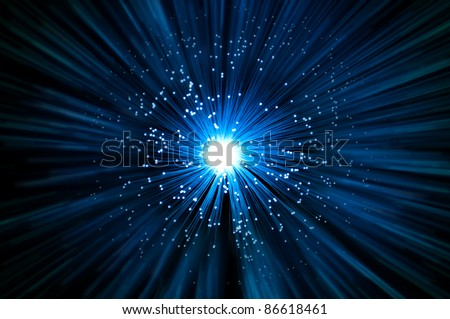 Many illuminated blue fiber optic light strands emitting a blue light effect blur against a dark background.
