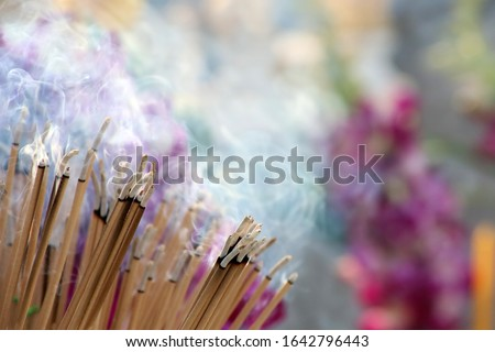 Many incense sticks were lit to perform Buddhist rituals, Smoke from a large amount of incense, Asian beliefs about Buddhist rituals, Religious ceremony Stock fotó ©