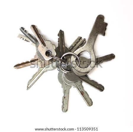 Many keys on a white background closeup