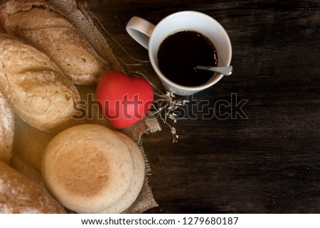 Many kind of bread and red heart cartoon ball put on handmade cloth on wooden table,prepare serve for breakfast or another meal. #1279680187