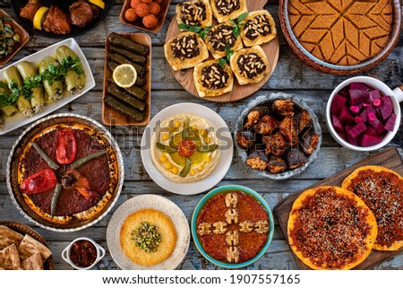 Many kinds of foods and appetizer on the dining table. Fasting concept with iftar table. Traditional foods concept.  Stock fotó ©