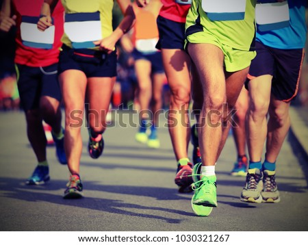 many legs of runners at finish line of an marathon with vintage effect #1030321267