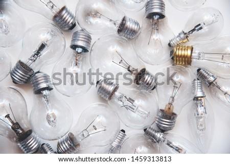 many lightbulbs and white background
