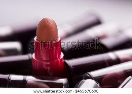 Many lipsticks. Multicolored lipstick. Lipstick closeup.