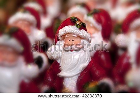 Many little statue of santa clause and one in focus