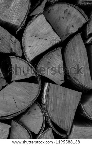 many logs chopped gray pattern background base toned rustic stack of firewood chopped #1195588138