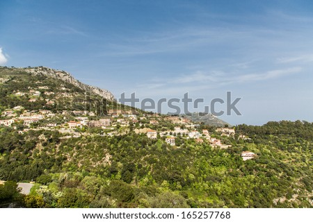 Many luxury homes and resort condos on a hillside near Eze