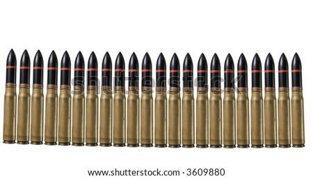 Many machinegun bullets in pistol bullet formation. War concept - stock photo