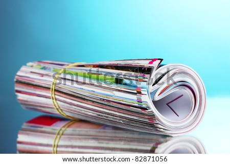 many magazines on blue background