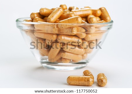 Many medicinal pills on glass plate. - stock photo