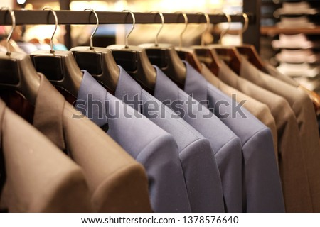 Many men suits hanging on a rack. Row of men suits hanging in closet. Concept of buy and sell, Business man, Gentleman and fashionable, shopping and suit fashion, luxury and elegant. #1378576640