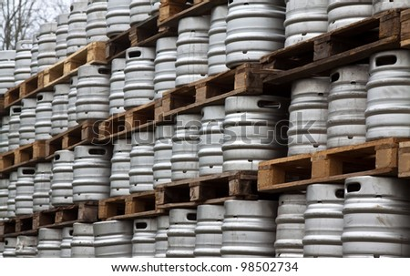 Many metal kegs of beer in regular rows