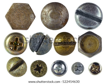 Many metallic screw heads, nuts, rivets isolated on white background close-up macro color copper and silver isolated on white background stock photo