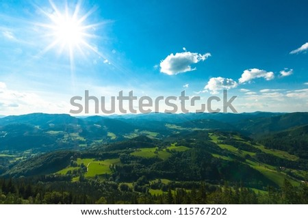 Many mountains with blue sky and clouds