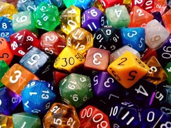 many multi colored and many sided dice with numbers