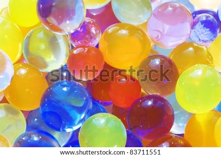 Many multi-colored balls as a cheerful background