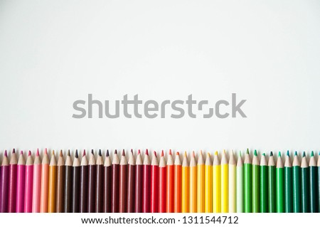 Many multi-colored pencils. Background with color pencils. Rainbow colors, palette. Bright and colorful backgrounds. #1311544712
