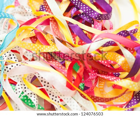 many multicolored gift ribbons