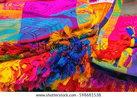 Many multicolored textiles being representative for the latin america culture and sold as souvenirs at chichen itza, yucatan mexico. #598681538