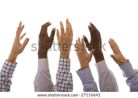 Many multiracial hands up isolated on white
