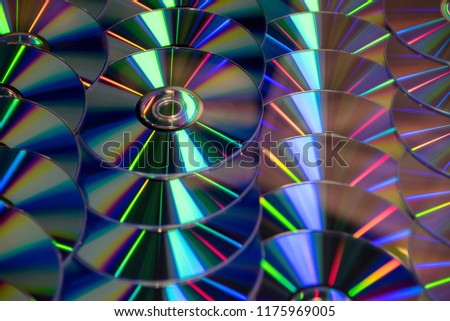 Many musical clean compact discs with a rainbow spectrum of colors as a bright background #1175969005