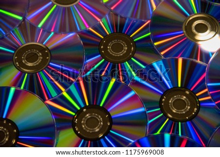 Many musical clean compact discs with a rainbow spectrum of colors as a bright background #1175969008