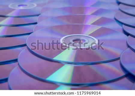 Many musical clean compact discs with a rainbow spectrum of colors as a bright background #1175969014