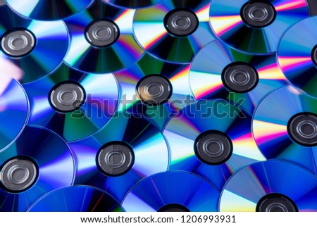 Many musical clean compact discs with a rainbow spectrum of colors as a bright background #1206993931