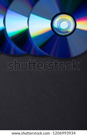Many musical clean compact discs with a rainbow spectrum of colors as a bright background #1206993934