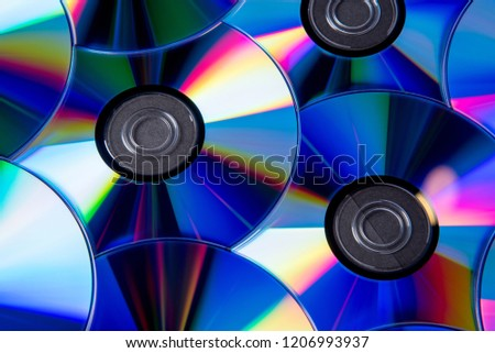 Many musical clean compact discs with a rainbow spectrum of colors as a bright background #1206993937