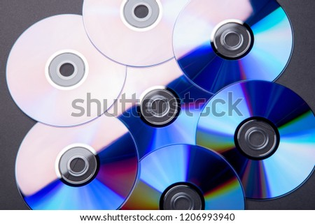Many musical clean compact discs with a rainbow spectrum of colors as a bright background #1206993940