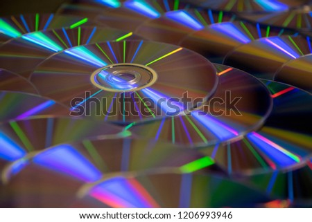 Many musical clean compact discs with a rainbow spectrum of colors as a bright background #1206993946