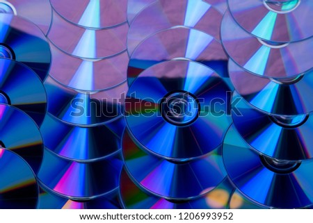 Many musical clean compact discs with a rainbow spectrum of colors as a bright background #1206993952