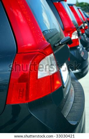 many new cars in a row on a car park