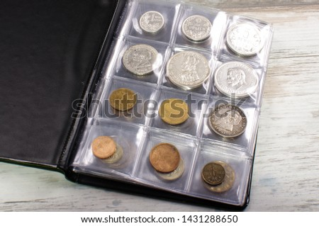 Many obsolete historical coins in the numismatics album #1431288650