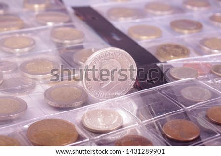 Many obsolete historical coins in the numismatics album #1431289901